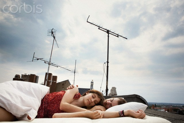 Couple sleeping on rooftop