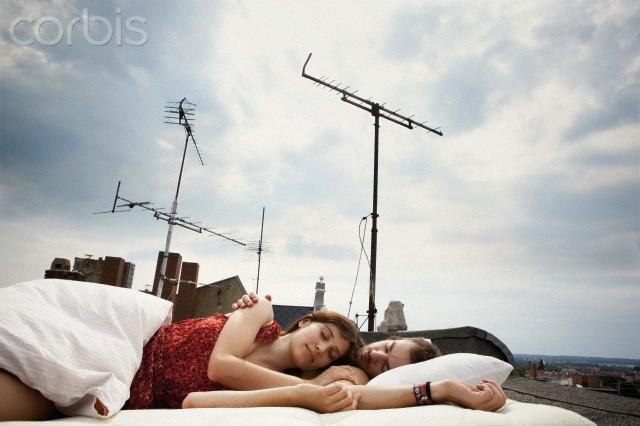 Couple sleeping on rooftop